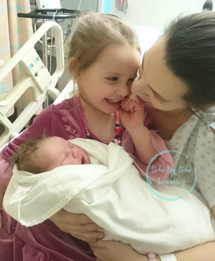 Newborn Sister Snuggles